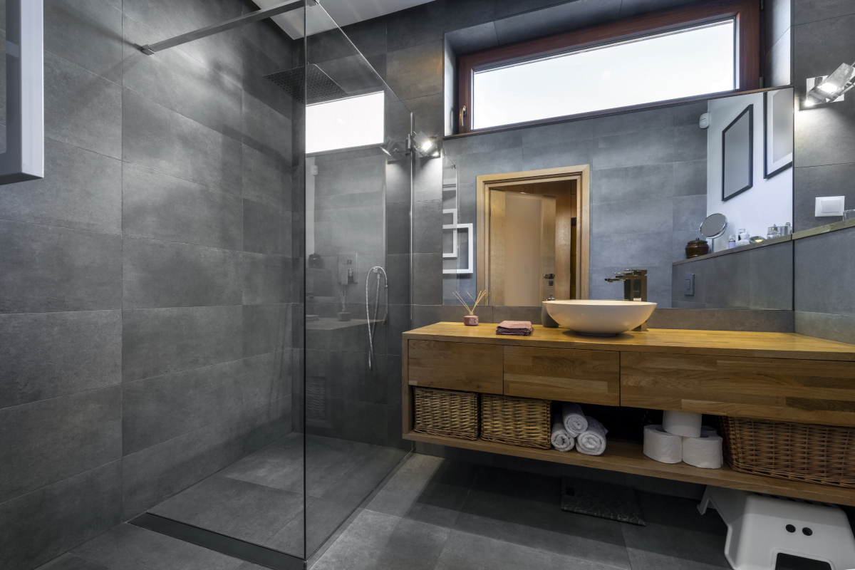 Modern bathroom with slate tiles and wooden counter