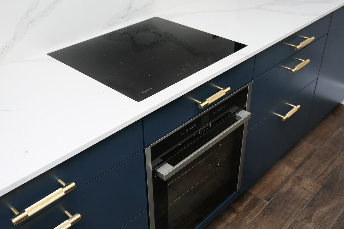 Close-up of kitchen drawers and an electric cooker