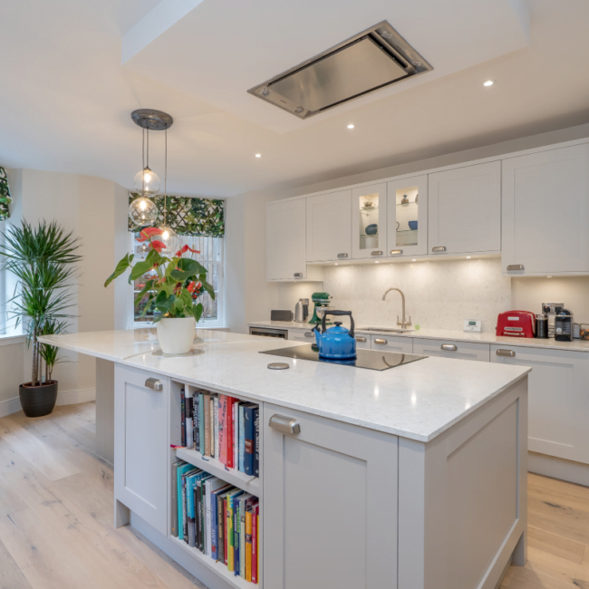 Beautiful new kitchen in Queen Street, Edinburgh with white finishes and an island counter